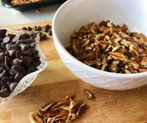 chocolate chips and chopped pecans in bowls