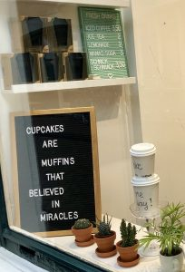 """Sign reading """"Cupcakes are muffins that believed in miracles"""""""