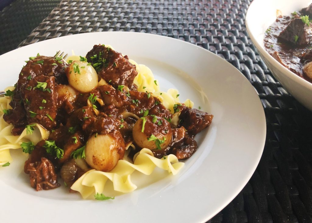 Beef Bourguignon over Noodles on Plate