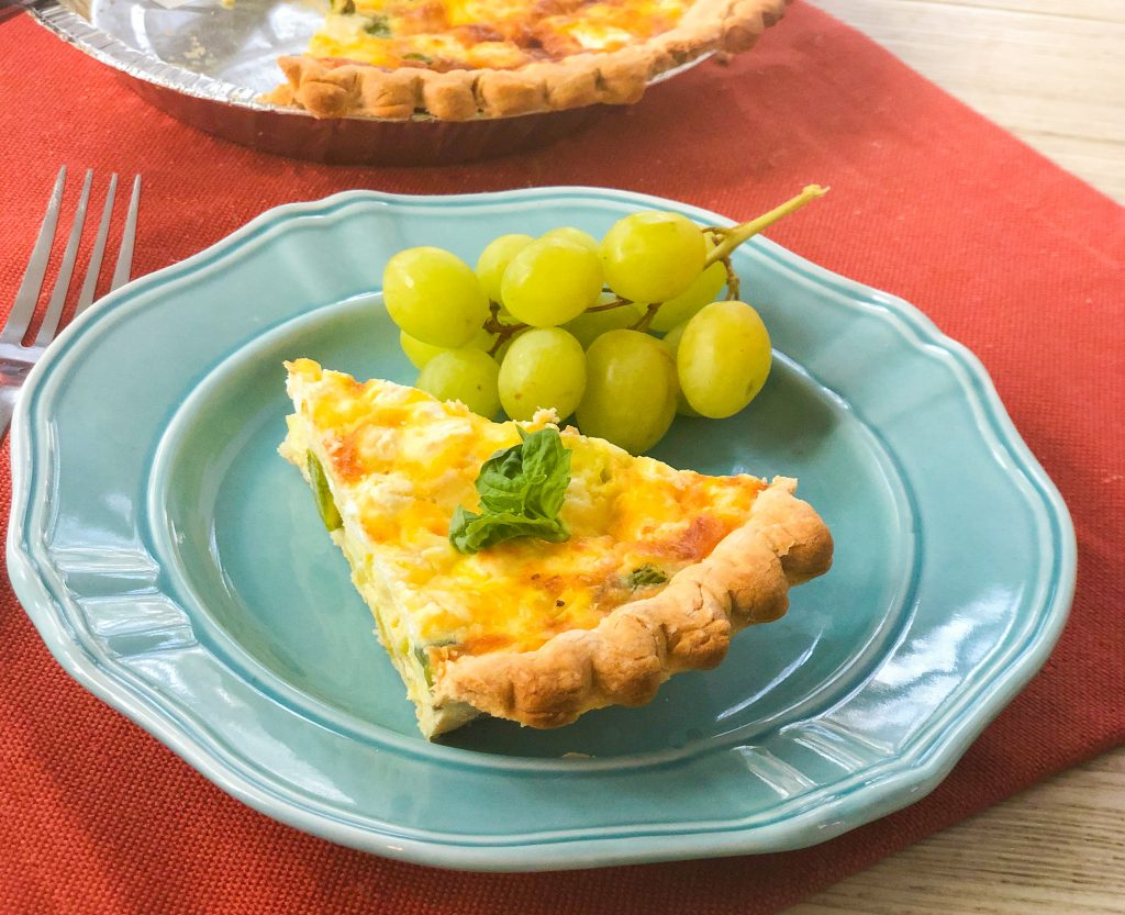 Slice of quiche on blue plate