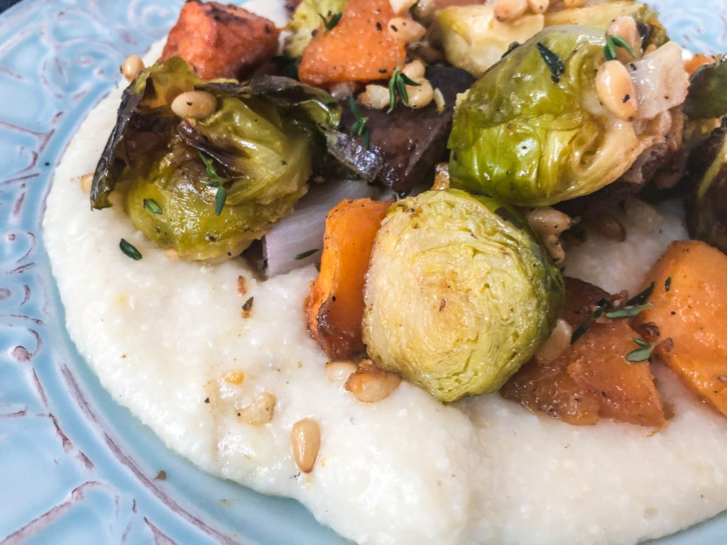 Close up of roast vegetables on grits