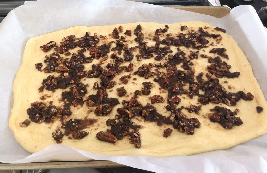 Brioche Dough covered in Pecan Praline