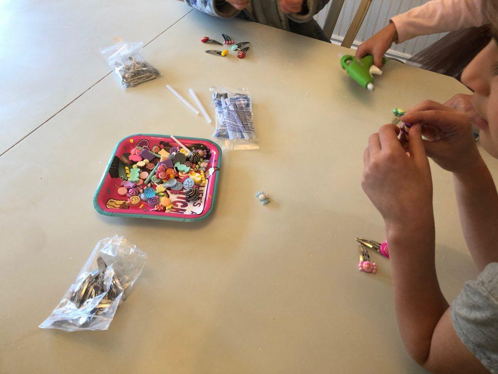 Girls assembling candy hair clips