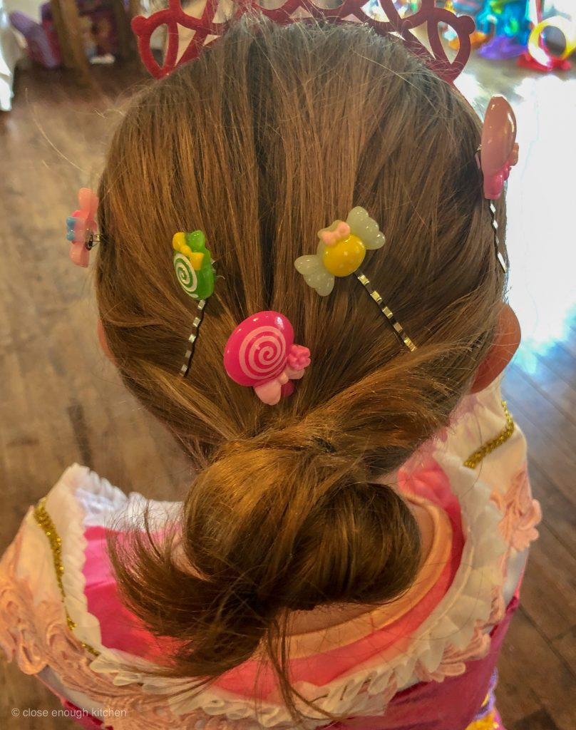 Candy hair clips in girl's hair
