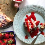 Slice of strawberry cake on plate with sauce